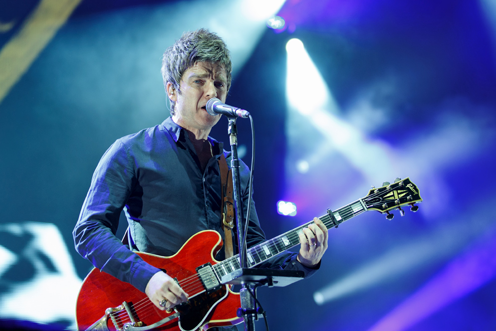 Noel Gallagher looks toward the camera during a set at Leeds First Direct Arena in April 2016. Photo © Katy Blackwood.